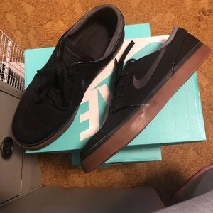 Nike black and brown shoes.